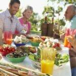 family enjoy lunch in garden 800